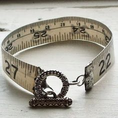 This tape measure bracelet...because I use one everyday.