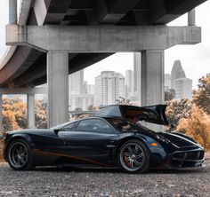 Pagani Huayra painted in Dark Blue w/ exposed Carbon Fiber and red accents  Photo taken by: @hypervelocitycars on Instagram (@napoleonsolo on Instagram is the owner of the car)