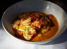 """Low Country shrimp is an impossibly rich, absolutely delicious plate of creamy Anson Mills grits, tender and mercifully not overcooked shrimp, and slices of andouille sausage. In a city full of mediocre shrimp-and-grits preparations, Grace's is the only one I have tasted that I regard as a must-have dish."""""""