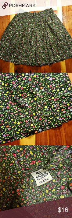 VS PINK Floral Mini Skirt Summery black mini full skirt with elastic waist and covered in a colorful floral pattern by Victoria's Secret PINK. Great condition- no defects or signs of wear. Size Medium. PINK Victoria's Secret Skirts Mini
