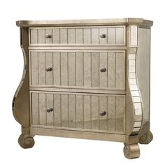 Offering elegant style for your home, this curvaceous 3-drawer chest showcases mirrored panels for a touch of glamour.  Product: Ches...