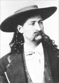 James Butler Hickok, aka Wild Bill Hickok. His skills as a gunfighter and scout, along with his reputation as a lawman, provided the basis for his fame, although some of his exploits are fictionalized.  He was shot and killed while playing poker in the Number Ten Saloon in Deadwood, Dakota Territory