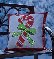 lighted outdoor pillow features a festive candy cane design with fiber optic led outline fun - Christmas Outdoor Pillows