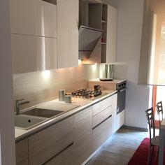 cucina scavolini modello liberamente anta decorativo larice avena e laccata lucida panna
