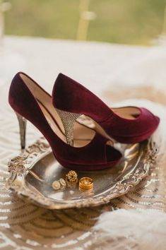 These stunning wedding shoes are perfect for a fall or winter wedding. These shoes are velvet burgundy heels with rhinestone bejeweled heels. Click to see more fun wedding planning ideas! Planning your wedding has never been so easy (or fun!)! WeddingWire has tons of wedding ideas, advice, wedding themes, inspiration, wedding photos and more. {Cassandra Lee & Co.}