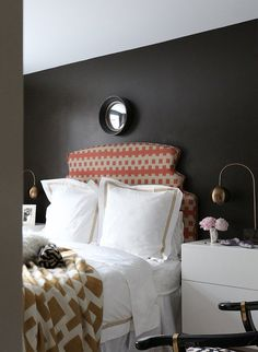 This designer painted her bedroom walls in a dark chocolate brown for a cozy, sexy vibe. Love it!