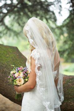 Bride wears wedding veil with lace scalloped edges | http://www.kimberleybrand.com/