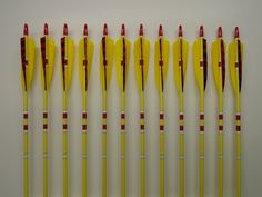 True North Arrows: Full Lt. Yellow Dipped Red Barred Nock Feather Matte Clear Finish (Item 0210)