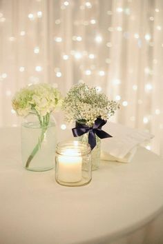 Mason jars/baby's breath + (advent color?) candles in jars  Inexpensive/simple centerpiece ideas