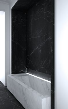 MFTB | Statuary White tub against Black Marquina marble wall