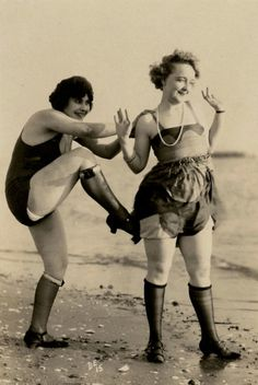 1928.  And, um, are those pearls around her neck?  Old bathingsuits are one thing... but the black knee sock look is just plain weird.