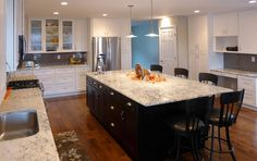 Nice blend of vintage  modern touches in this kitchen with Bianco Romano granite countertops and SOLLiD® Cabinetry.