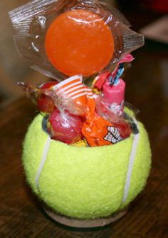 Ball Favor.  What a clever idea to turn a tennis ball into a basket and fill with treats.