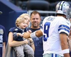 hawkins romo photos | ... Romo (9) meets with his wife Candice Crawford and son Hawkins prior to