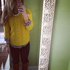 Loving the yellow sweater with her shirt