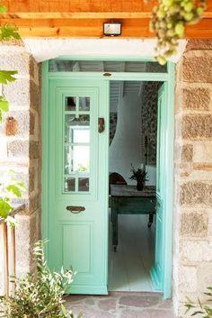 Stone facade, mint painted door.