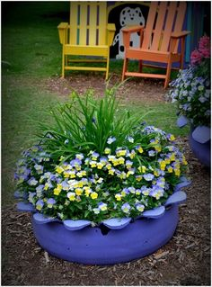 Old Tire Flower Bed (my dad used to make these for my mom, and im thinking i can convince him to make me one! i want to do something simple and adorable like this for audrey so she can help mama, and she will have a place to pick flowers when mum tells her to stay out of the roses and alliums :})