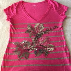 "Fun Floral Express Pink Tee with Sequins! Express V-Neck Short Sleeve Tee Pink with Tan Stripes Multi-color sequins in floral design pattern- All appear intact Size S  -EUC, Worn maybe twice -Inside tags Removed   Reasonable offers will be considered thru ""offer"" option  ⛔️ No Trades, PP or Holds Express Tops Tees - Short Sleeve"