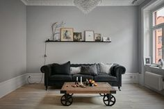 livingroom in a lovely apartment in grey shades at fantastic frank via http://www.scandinavianlovesong.com/