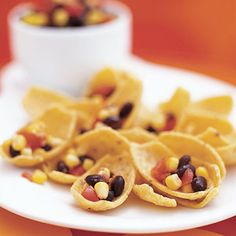 Corn and bean salsa is a tasty, #healthy snack for after school or on game day. http://www.parents.com/recipe/appetizers-snacks/salad-scoops/?socsrc=pmmpin100912hsSaladScoops