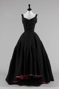 Button front silk faille ballgown, 1950, Pierre Balmain. Love the pink lining peeking at the bottom. :-)