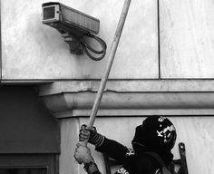 Anti-surveillance activists turn smashing CCTV cameras into a competitive game… Story Inspiration, Writing Inspiration, Cyberpunk, Refugees, By Any Means Necessary, Retro Mode, Banksy, Urban Art, Photos