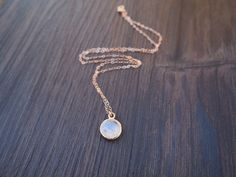 An elegant rose gold necklace with an eye catching moonstone pendant.The rainbow moonstone reflects light in an intriguing and stunning way. Great