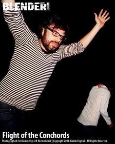 Jemaine. Flying. Dancing. Something.