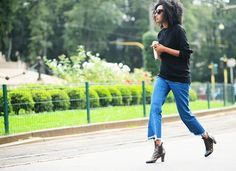 Julia Sarr Jamois in an oversized black knit, frayed jeans and ankle boots Jeans Kick Flare, Flare Jeans Outfit, Julia Sarr Jamois, Milan, Garance, Ootd, Denim Trends, Who What Wear, Cropped Jeans