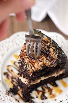 Sinful Samoa Cake- A rich chocolate cake with caramel cream cheese and topped with toasted coconut and caramel.