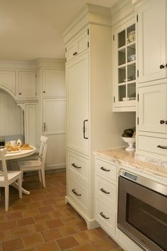 by Kayron Brewer, AKBDSeattle, WA, US ·  57 photosadded by kayronlb		Sage Green Inset Door Kitchen  			This remodeled kitchen was transformed from a tiny compact kitchen to a small scale kitchen with much improved flow and storage.  The space has become the central location for family interaction.  An arched wall of a breakfast room was removed to create a better flow and layout to the space.  We created the remembrance of the original arch within the new cabinetry detail over the built in…