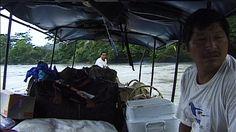 MANU, PERU - August 15: Indians on canoe in Amazon Rainforest on August 15, 2006 in Manu, Peru.