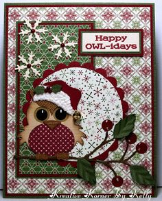 """By Kelly. So cute! She used the Go Kreate Owl with the hat from the Scrapping Cottage """"Santa Peeker,"""" perched him on the """"Twigs and Berries"""" die from Memory Box and added snowflakes from a Cuttlebug die. Added Glossy Accents to berries and Liquid Applique to hat."""