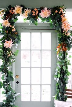 Eucalyptus garland peppered with berries and flowers adds a feminine touch to this traditional look