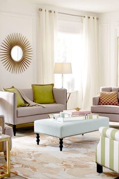 Tip! To maximize space in your living room, choose an upholstered ottoman  that can double as a coffee table, styled with your favorite trays and books. Click to find living room furniture you love on Wayfair!