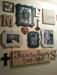 My DIY family photo wall / gallery wall in my hallway with frames from hobby lobby, modge podge scrapbook wall letters and diy painted fabric canvases, along with other nick nacks I found at hobby lobby!! by elizabeth