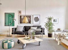 Salón estilo nórdico con suelos de madera