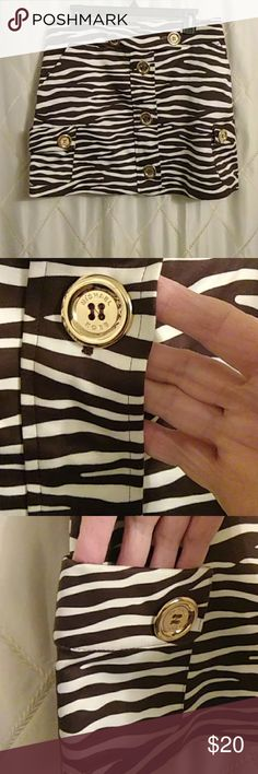 Adorable Michael Kors Zebra Skirt sz 10 Super cute mini skirt in excellent condition. Has many pockets. Made in Italy , such quality. Michael Kors Skirts Mini