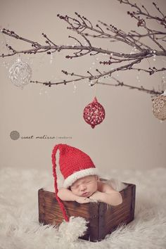 I don't like the way the baby is posed (looks uncomfortable) but I love the ornaments.