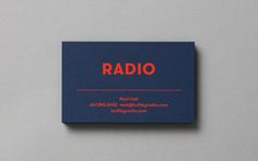 Radio brand identity and business cards with red foil and blue card detail designed by Tung.