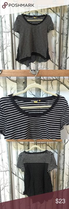 Anthropologie Little Yellow Button Hi-Low Top Anthropologie Little Yellow Button Hi-Low Top.  Stripes and Little Dots, this top has white and deep dark navy/black and white stripes on the front and sleeves and on the lower hanging back there are tiny white embroidered dots on the deep navy/black background.  Excellent Brand New Condition.    74% Cotton 26% Poly.  Has Side Ties to Cinch the Waist in and Customize Fit and Look. Anthropologie Tops Tees - Short Sleeve