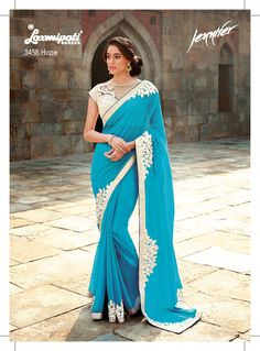 """"""" Beauty is being the best possible version of yourself on the inside and out."""" - This impressive cyan color saree with floral resham embroidery patch+ diamond studded make you to feel angelic. The resham embroidery on net blouse with silver brocade inner enhances its beauty to a great extent."""