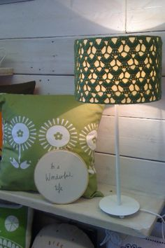 Green crocheted lampshade. Like the idea of this.