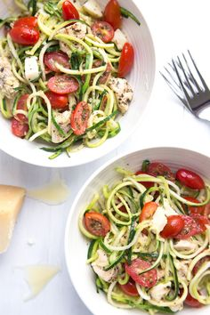 "Caprese Zoodle Bowls - Lightly sauteed zucchini ""noodles"" tossed with marinated tomatoes, chicken, and mozzarella. My ALL-TIME favorite zucchini recipe! 