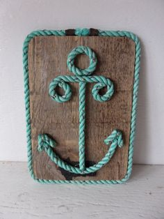 Reclaimed Wood with Rope Shaped Anchor Nautical Decor Wall Hanging Sign Nautical Nursery Coastal Beach Decor by AlaskaRugCompany on Etsy https://www.etsy.com/listing/174409421/reclaimed-wood-with-rope-shaped-anchor