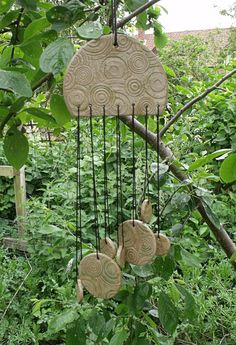 These wind chimes are ideal for any garden and the ceramic forms give a gentle sound unlike most steel or bamboo chimes on the market. Description from etsy.com. I searched for this on bing.com/images