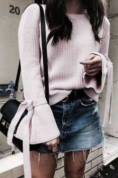 Soft pink sweater with blue denim skirt.