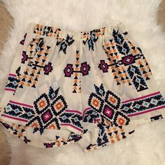 "• White Printed Shorts • Printed shorts with elastic waist. Laying flat the waist = 12"" ** they are a large but I wear a medium and they fit me just fine! Shorts"