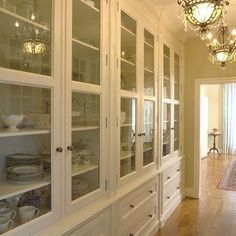 tall glass cabinets with drawers below - reminds me of my allston apartment