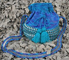 Inspired by the beautiful Colombian Wayuu Mochila, this unique bucket bag is an exclusive product made with recycled soda tabs. You will love that it is soft but at the same time strongly made to carry all of your belongings. We guarantee a high quality product that you will love to